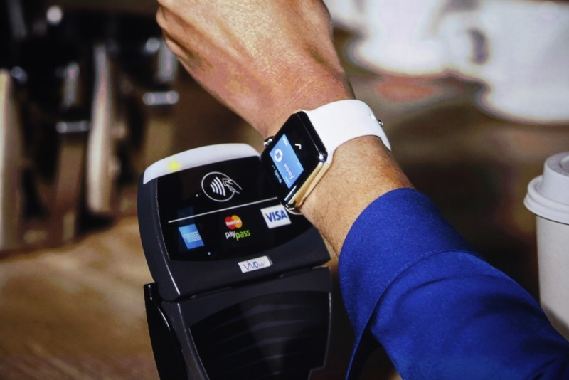 An Apple Watch is shown making a tap transaction during an Apple event at the Flint Center in Cupertino, California, September 9, 2014. REUTERS/Stephen Lam (United States - Tags: SCIENCE TECHNOLOGY BUSINESS)